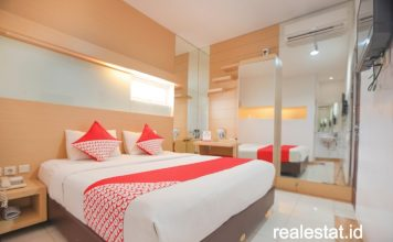 kamar OYO Hotel Sanitized Stay realestat id dok