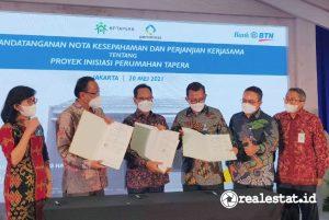 Penandatanganan Nota Kesepahaman antara BP Tapera, Bank BTN, dan Perum Perumnas tentang Proyek Inisiasi Penyaluran Pembiayaan Tabungan Perumahan Rakyat, di Jakarta, Kamis, 20 Mei 2021 - (Foto: Dok. Bank BTN).